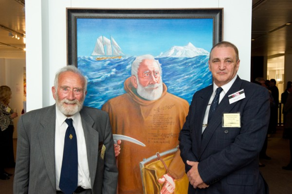Neil Liddell with his portrait of Colin Putt at the PAA exhibition in Canberra, 2012