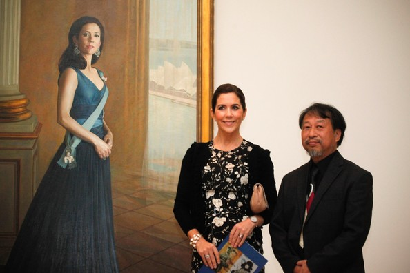 Princess Mary and  Jiawei Shen in front of the portrait