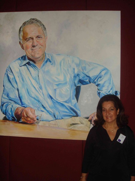 Vivian Falk with her portrait of Malcolm Turnbull at NSW Parliament House in the PAA exhibition.