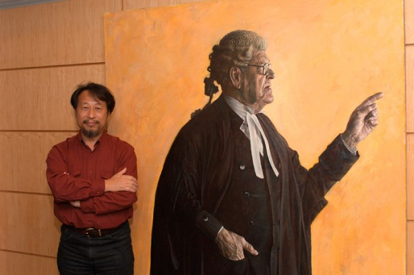 Jiawei at the PAA opening in 2005 at the Embassy of Australia in Washington DC with his portrait of Tom Hughes