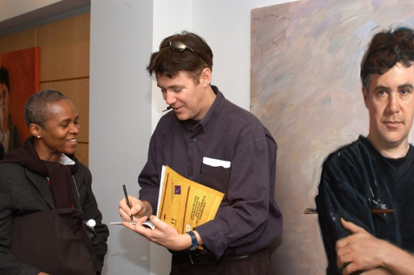 Paul Newton signing autographs in form of his self portrait at the Embassy of Australia Washington DC PAA exhibition 2005
