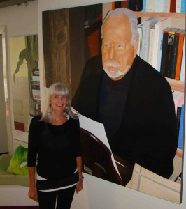 Polly Ifould  with her portrait of Jeffrey Smart