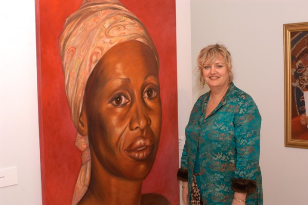 Robyn Ross at the Embassy of Australia Washington DC 2005 with her portrait of 'Benedicta'