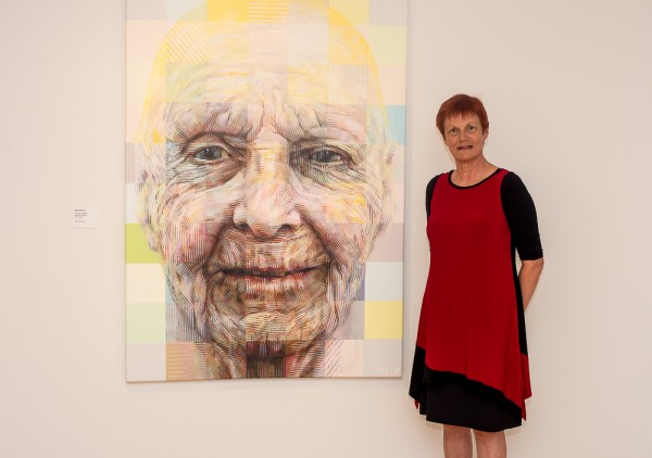 Sally Robinson with the award winning portrait of her mother at the PAA Exhibition in Washington DC 2014