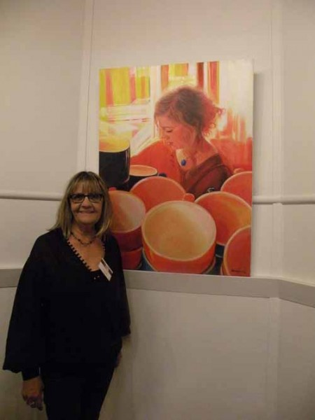 "Beverley Craig at the PAA VAS exhibition with her portrait of ""The Barista"" 2014"