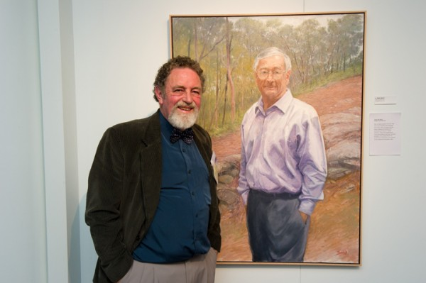 Bob Baird at PAA Canberra opening 2012 with his portrait of Dick Smith
