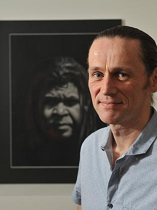 Ray Coffey with his portrait of a homeless man